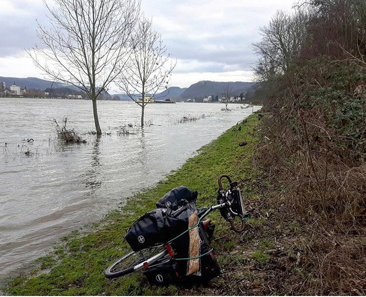 Frances Grier bike on flooded banks outside of Bonn