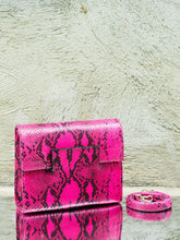 Pink Snake Print Leather Clutch