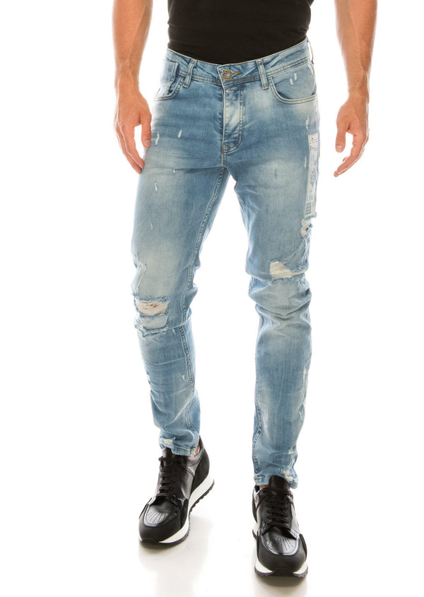 DISTRESSED AND PAINTED SLIM FIT LIGHT INDIGO JEANS
