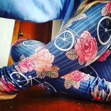 These leggings are a whimsical playful print with some lovely coral and melon colored flowers on a blue pinstriped background. The bicycles are retro and fun. They would pair well with several different options of tops.