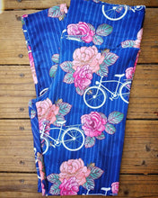 Soft printed leggings. Hand drawn peach and coral roses dance with ivory vintage bicycles on a subtly striped periwinkle background.
