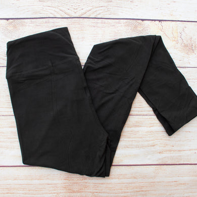 These classic black leggings are solid dark black and feature a yoga waistband and buttery soft brushed texture.