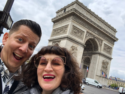Posing in front of the Arc de Triomphe