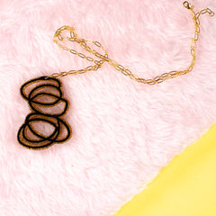 Janus black and gold necklace