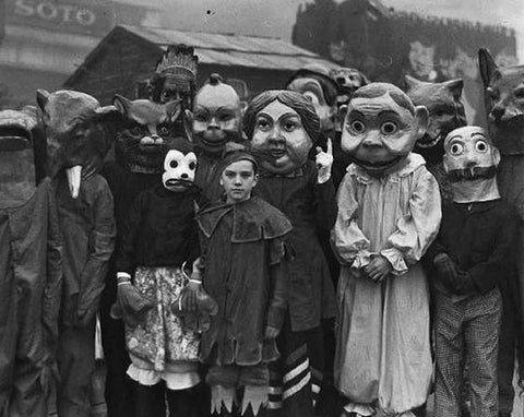 old b/w image of people in halloween costumes