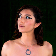 Load image into Gallery viewer, black ouroboros necklace on model