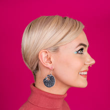 small black boar earrings on model