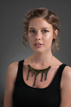 Load image into Gallery viewer, drip black and gold glitter necklace on model