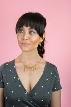 sparkly gold necklace on model
