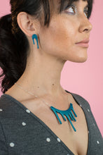 Load image into Gallery viewer, shimmering blue stud earrings on model