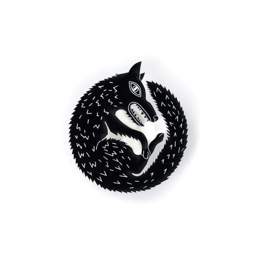 black wolf pin on white background