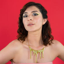 drip gold statement necklace on model