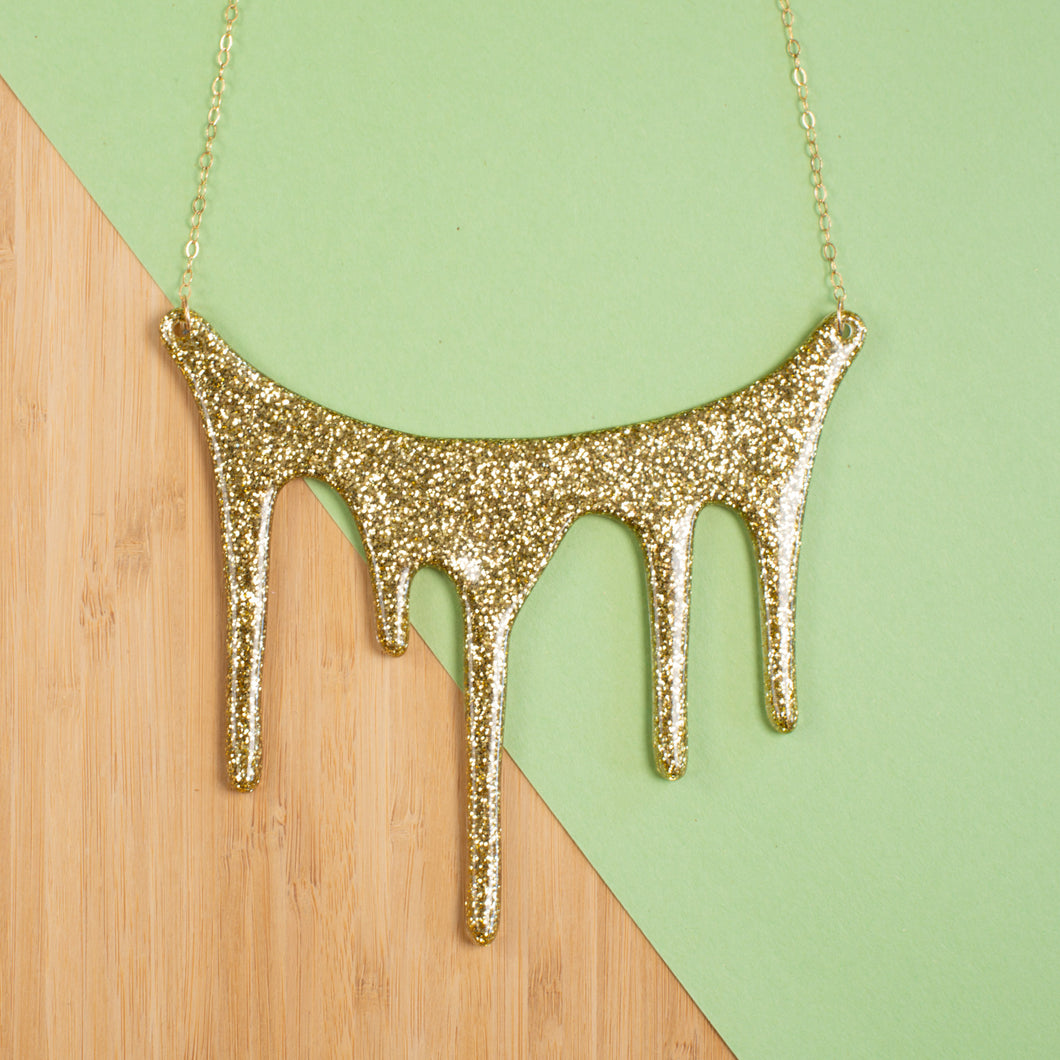 Drip gold statement necklace styled