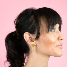 glittery gold stud earrings on model