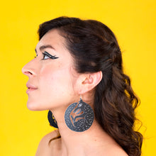 Load image into Gallery viewer, large black wolf earrings on model
