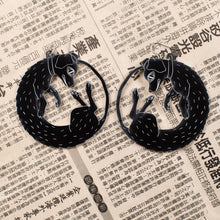 Load image into Gallery viewer, large black dog earrings on newspaper