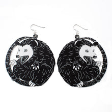 Load image into Gallery viewer, large black and white possum earrings over white