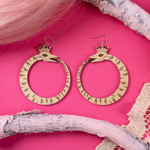 Load image into Gallery viewer, large wood ouroboros earrings over pink background