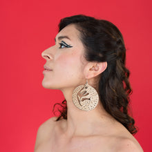 Load image into Gallery viewer, large wood wolf earrings on model