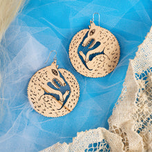 Load image into Gallery viewer, large wood wolf earrings on blue background