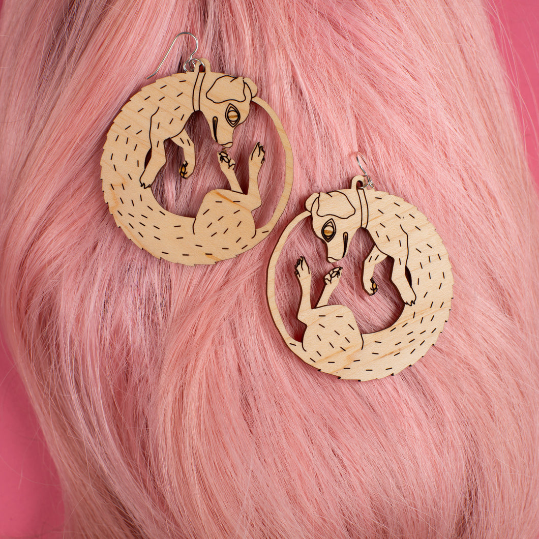 large wood dog earrings on pink wig