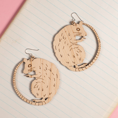 Large Wood Rat Earrings on notebook