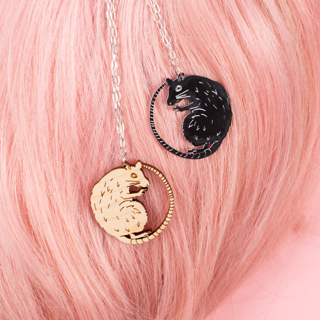 wood rat necklace & black rat necklace on pink wig