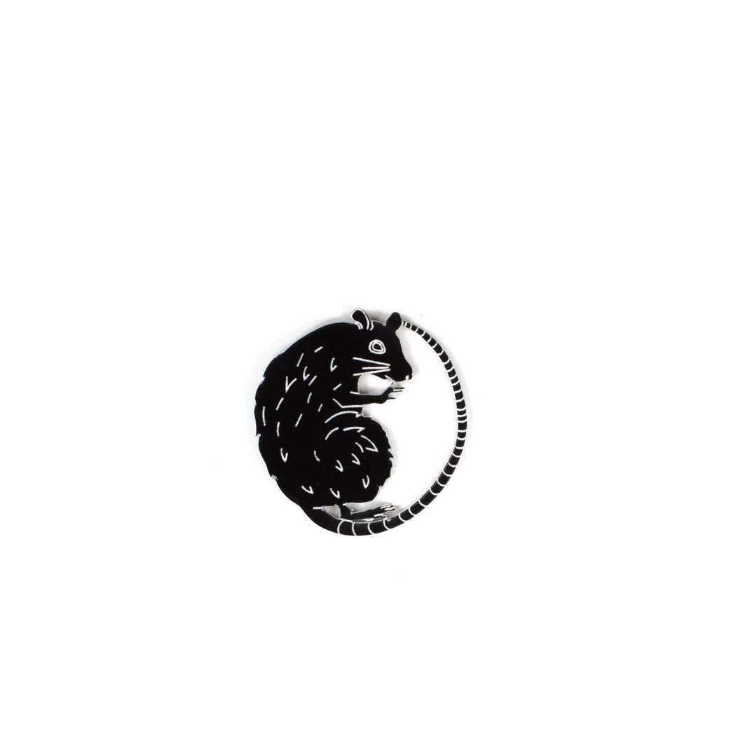 black rat pin on white background
