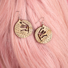 small wood wolf earrings on pink