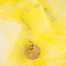 Load image into Gallery viewer, wood wolf necklace on yellow background