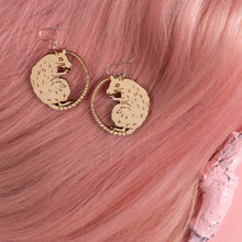 Load image into Gallery viewer, small wood rat earrings on pink wig