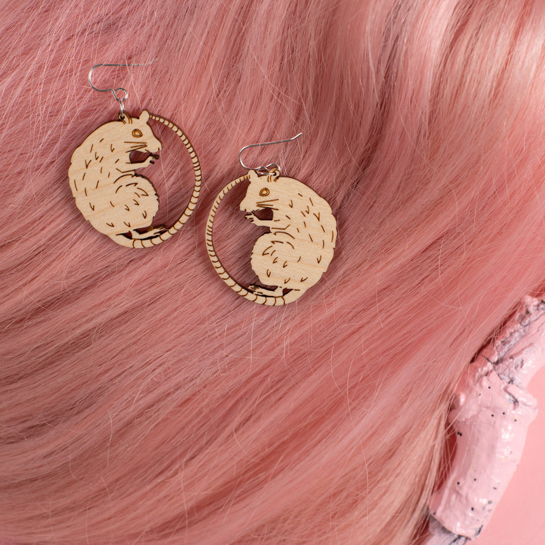 small wood rat earrings on pink wig