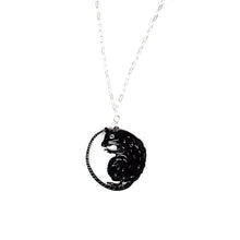 rat necklace on white background