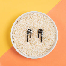 black and silver stud earrings in rice