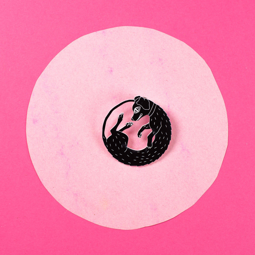 black dog pin on pink background