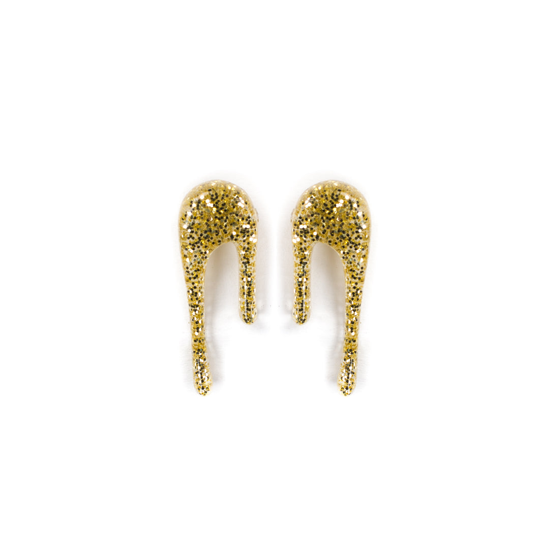 glittery gold stud earrings over white