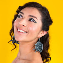 large black cat earrings on model