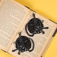Load image into Gallery viewer, large black cat earrings styled on book
