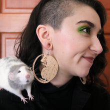 large wood rat earrings on model with rat