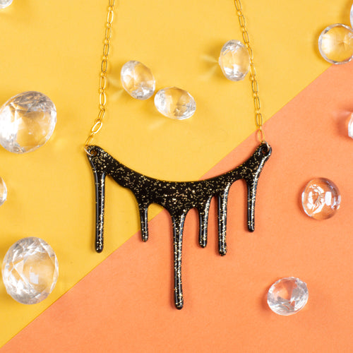 black and gold glitter necklace styled