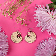 Load image into Gallery viewer, small wood boar earrings styled with flowers