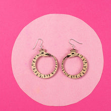 Load image into Gallery viewer, small wood ouroboros earrings styled over pink background