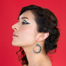 Load image into Gallery viewer, small black ouroboros earrings on model