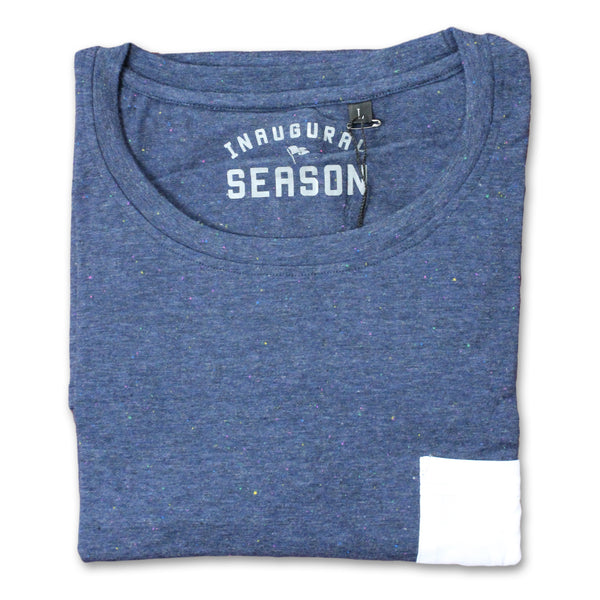 A premium, unisex t-shirt made of blue cotton with a white pocket, folded.