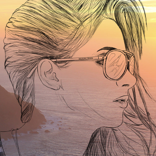 A close up of a graphic on white tshirt.  Girl and sunset.