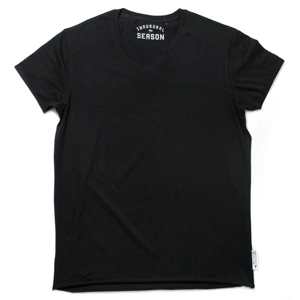 A premium, v-neck t-shirt made of black cotton on a white background.