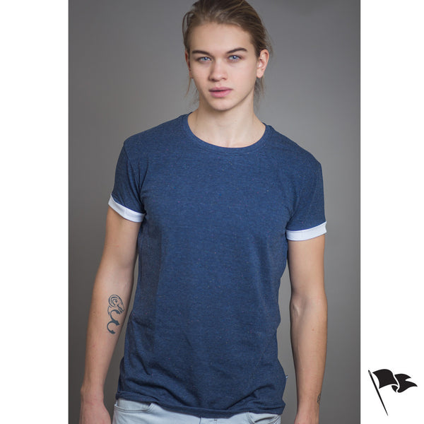 A model wearing a premium, unisex t-shirt made of blue cotton.