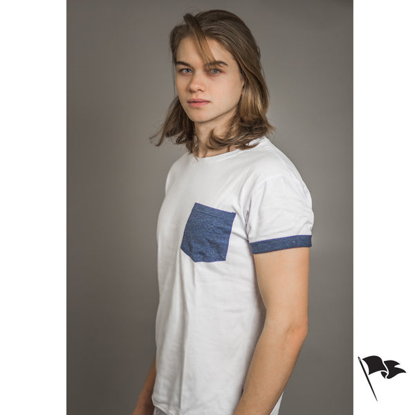A model wearing a premium, unisex t-shirt made of white cotton with a blue pocket.