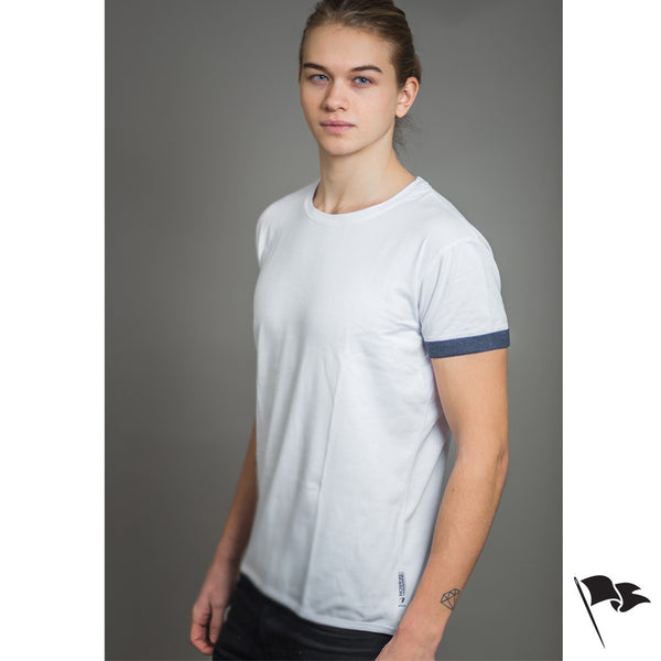A model wearing a premium, unisex t-shirt made of white cotton.