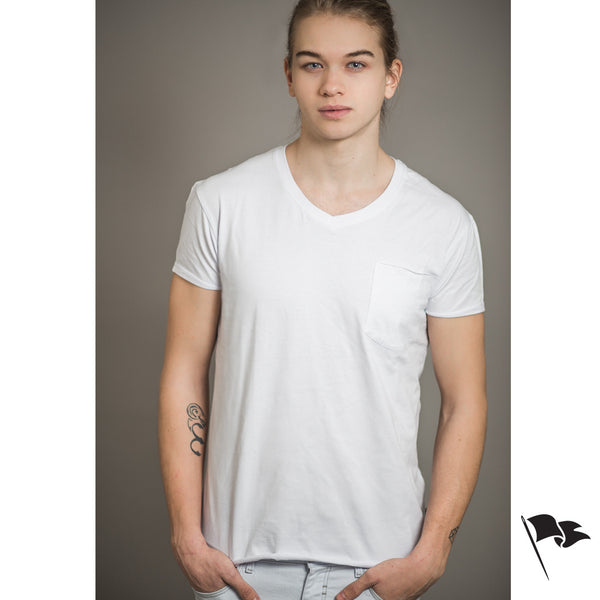 A model wearing a premium, v-neck t-shirt made of white cotton.